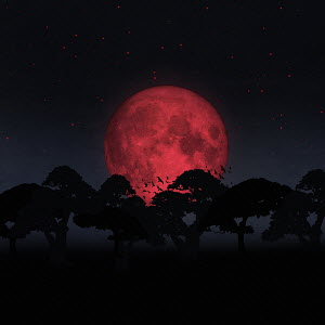 Trees silhouetted by huge red moon