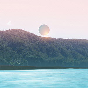Pink sun above turquoise lake