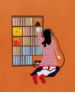 Girl listening to LP from large record collection