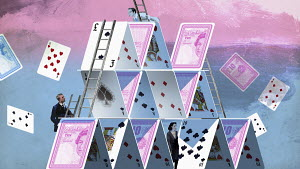 People climbing collapsing financial house of cards