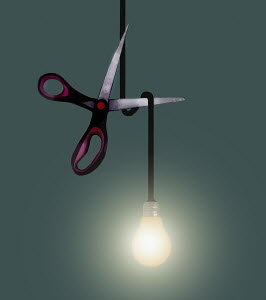 Scissors cutting light bulb wire
