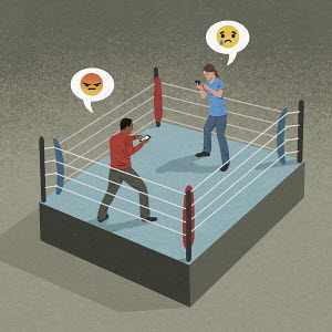 Couple in boxing ring having fight on phones