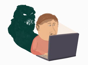 Man on computer with monster as shadow