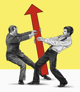 Two businessmen fighting over direction of arrow
