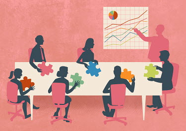 Business people with multicolored jigsaw puzzle pieces in meeting