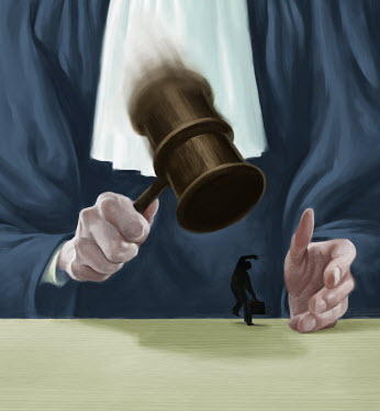 Large judge banging gavel on small businessman