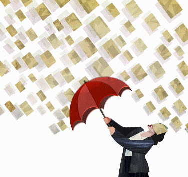 Papers raining on businesswoman holding umbrella