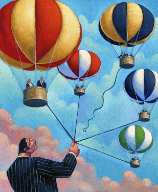 Businessman holding bunch of hot air balloons and letting one go