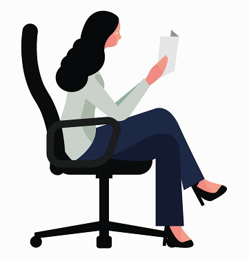 Businesswoman sitting in office chair reading document