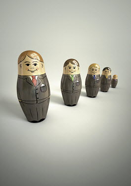 Row of happy, smiling businessman nesting dolls