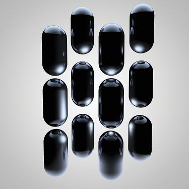 Group of shiny black capsules
