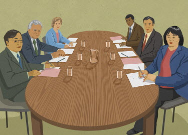 Multicultural group of businesspeople sitting at boardroom table