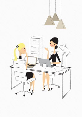 Office workers talking sharing a desk
