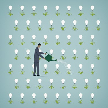Businessman watering rows of light bulb plants