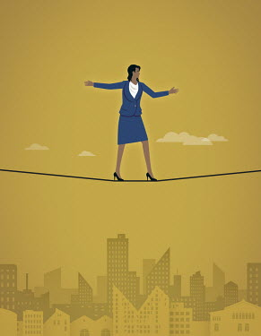 Businesswoman balancing on tightrope in high heels