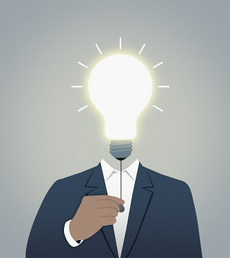 Businessman turning on light bulb head
