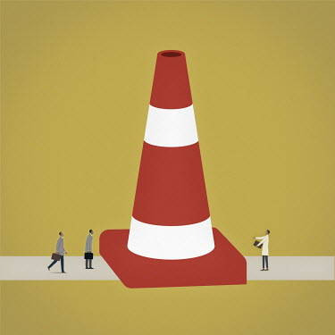 Frustrated business people separated by large traffic cone blocking the road