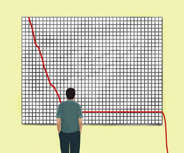 Businessman looking at line graph falling off chart
