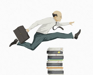 Businessman jumping over pile of paperwork