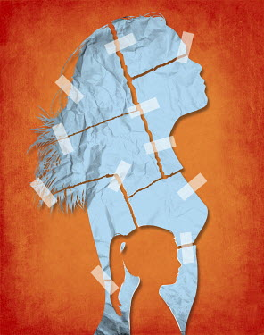Small girl's profile cut out from crumpled paper woman