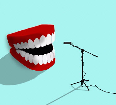 Laughing fake teeth talking into microphone