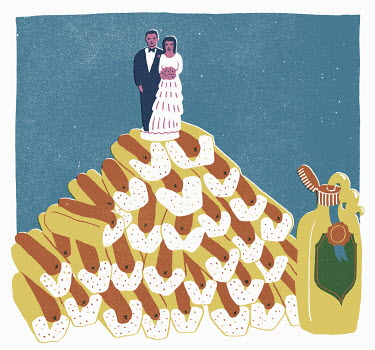 Bride and groom figurines on pile of hot dogs instead on wedding cake