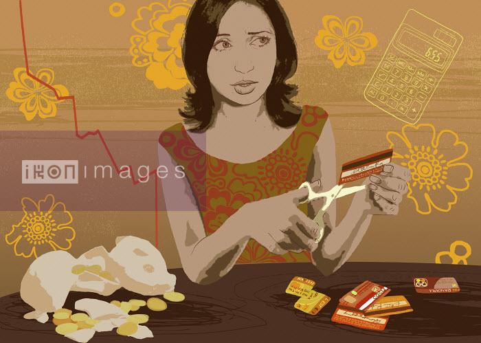 Woman cutting credit cards - Woman cutting credit cards - Marina Caruso