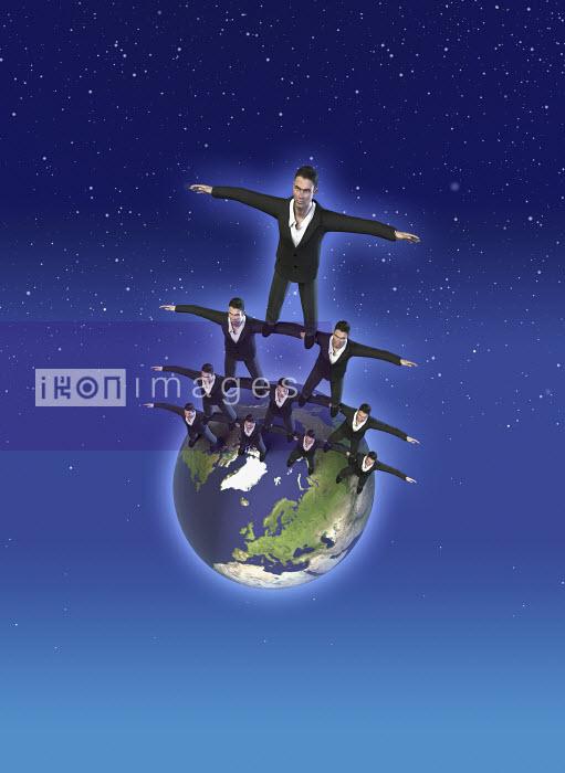 Businessmen balancing on earth - Businessmen balancing on earth - Oliver Burston