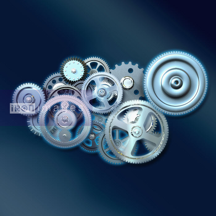 Group of cogs turning together - Group of cogs turning together - Oliver Burston