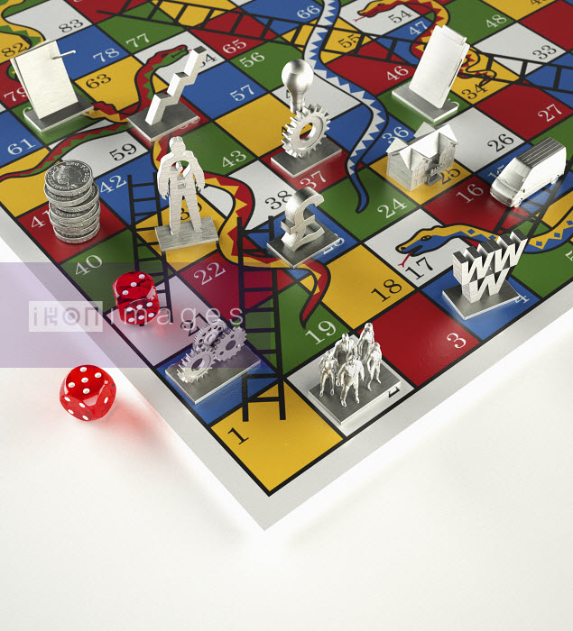 Tokens and dice on Snakes and Ladders game - Tokens and dice on Snakes and Ladders game - Oliver Burston