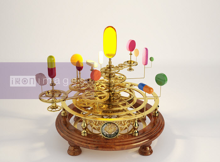 Pills and capsules on clockwork orrery - Pills and capsules on clockwork orrery - Oliver Burston