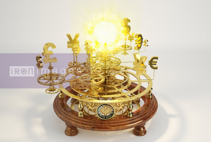 Gold international currency symbols on clockwork orrery around sun - Gold international currency symbols on clockwork orrery around sun - Oliver Burston