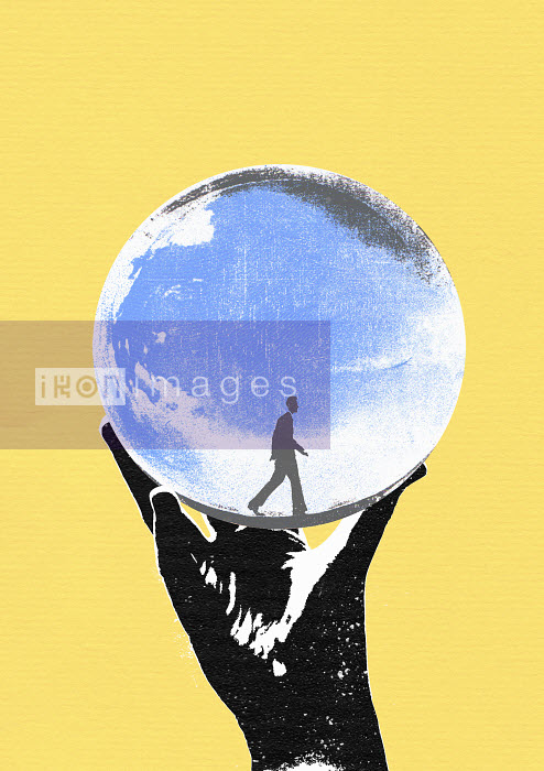 Hand holding crystal ball with walking man - Hand holding crystal ball with walking man - Katie Edwards