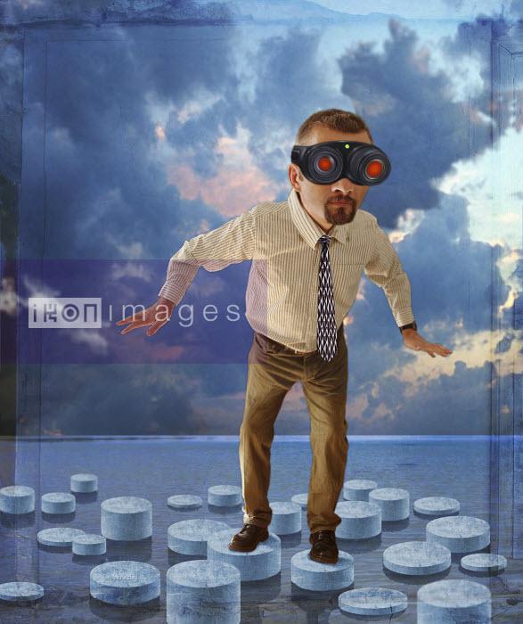 Man stepping on stones wearing night vision goggles - Man stepping on stones wearing night vision goggles - Jon Berkeley