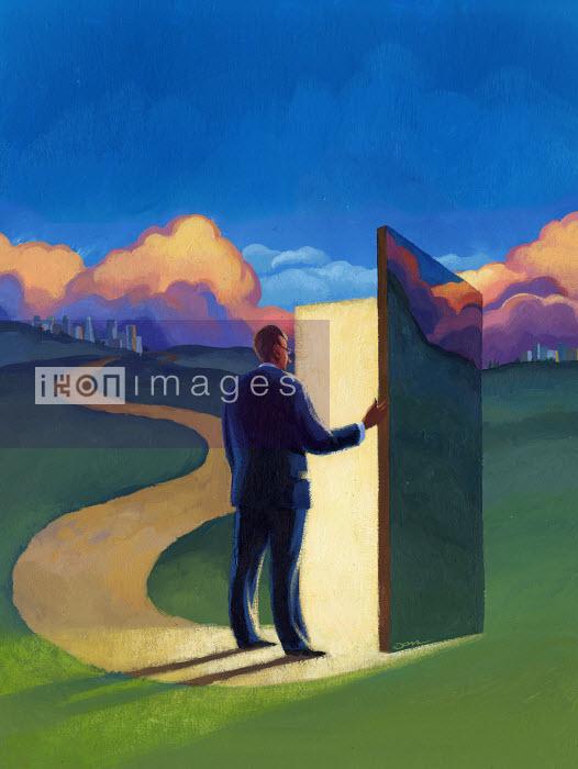 Businessman in field opening door in background - Businessman in field opening door in background - Jon Berkeley