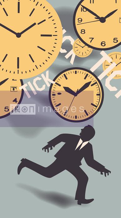 Businessman running to escape ticking clocks - Businessman running to escape ticking clocks - Andrew Baker