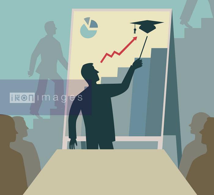 Businessman showing graduate education success on graph to business meeting - Businessman showing graduate education success on graph to business meeting - Andrew Baker