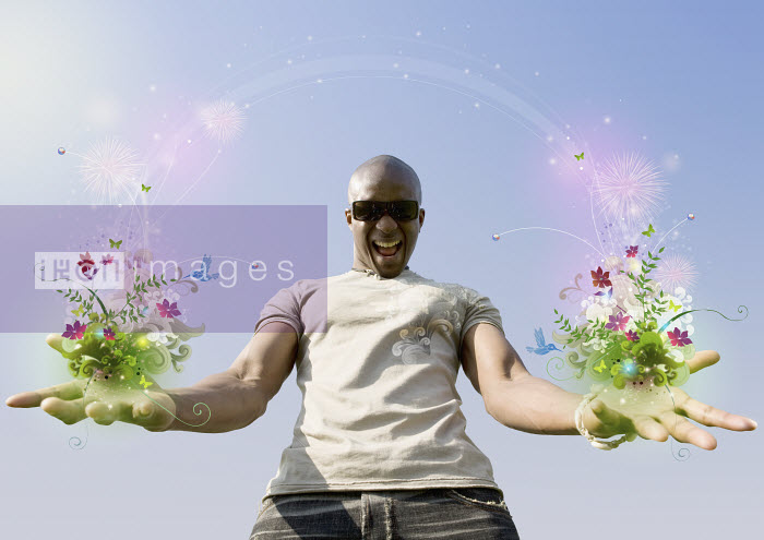 African man holding flowers and vines - African man holding flowers and vines - Aeriform & Maria Teijeiro