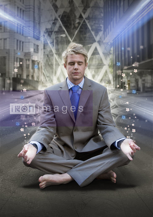 Businessman meditating on urban street - Businessman meditating on urban street - Aeriform & Maria Teijeiro