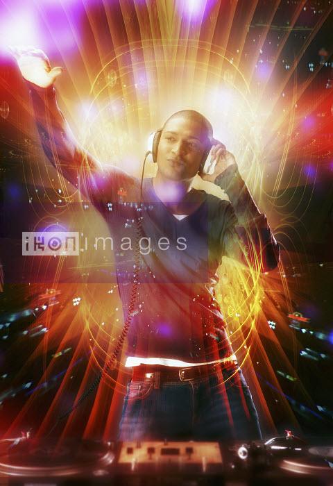 Jason Jaroslav Cook & Maria Teijeiro - Male DJ playing music