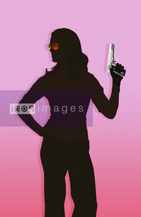 Silhouette of woman holding handgun - Silhouette of woman holding handgun - Matt Herring