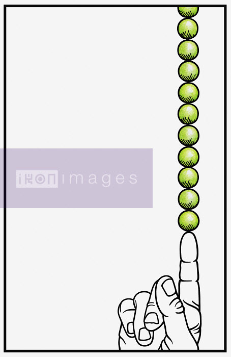 Stack of peas balanced on pointing finger - Stack of peas balanced on pointing finger - Cath Riley