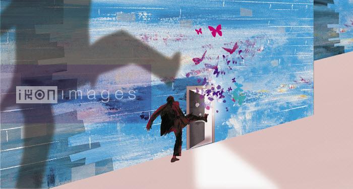 Businessman kicking open door with butterflies flying out - Businessman kicking open door with butterflies flying out - Jo Empson