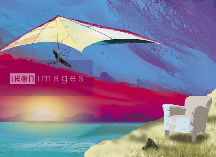 Armchair on cliff with hang-glider soaring over ocean - Armchair on cliff with hang-glider soaring over ocean - Jo Empson