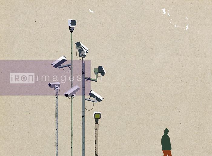 Man waking beneath surveillance cameras - Man waking beneath surveillance cameras - Paul Jackson