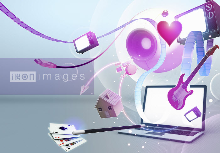 Multimedia entertainment emerging from laptop screen - Multimedia entertainment emerging from laptop screen - Magictorch