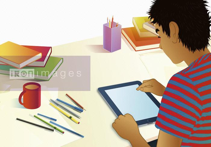 Teenage boy using digital tablet for homework - Teenage boy using digital tablet for homework - Magictorch