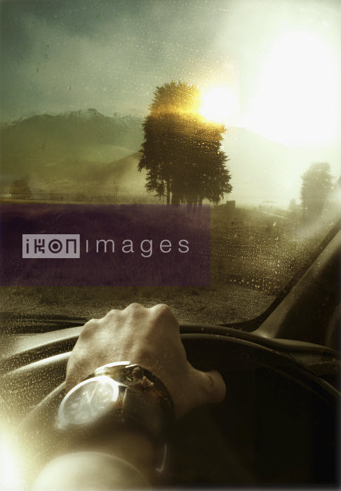 Man driving car in countryside - Man driving car in countryside - Jason Jaroslav Cook