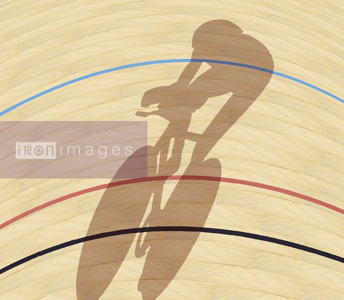 Cyclist casting shadow on indoor track - Cyclist casting shadow on indoor track - Andy Bridge