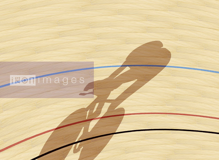 Cyclist casting shadow on indoor track - Cyclist casting shadow on indoor track - Andy Bridge
